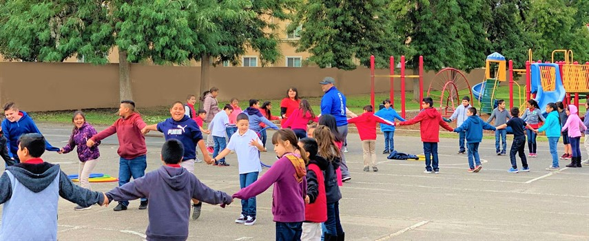 Students enjoying a day outside during P.E. time with one of our Physical Education teachers, Mr. Martinez.
