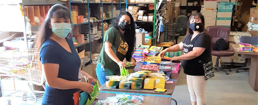 AUSD staff creates packets of materials for students